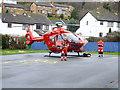 SH8076 : Air ambulance at Ysgol Glan Conwy by Richard Hoare