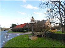 TL3656 : Toft village sign by Bikeboy