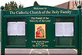 TQ2550 : Noticeboard, Church of the Holy Family by Ian Capper