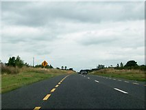 N4040 : Approaching a minor junction on the N52 at Clonfad, Co Westmeath by Eric Jones
