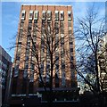 SJ8398 : Office block and winter trees, Lincoln Square by Andrew Hill