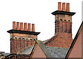 J3374 : Chimneys and chimney pots, North Street, Belfast by Albert Bridge