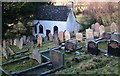 SO2531 : Gravestones old and new by Peter Evans
