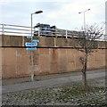 SJ8990 : Footpath signs under the motorway by Gerald England