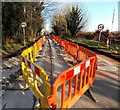 ST8993 : Yellow and orange barriers along Cirencester Road, Tetbury by Jaggery