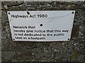 TM2647 : Sign on Broomheath Railway Bridge by Adrian Cable