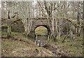 NH5650 : Old railway bridge, Spittal Wood by Craig Wallace
