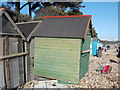 SZ1992 : Mudeford: a beach hut shifted by the storm by Chris Downer