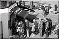 NZ6621 : Queue for the Fish Shop by Mick Garratt