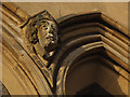 TQ3975 : Carved stone head on St Margaret's church by Stephen Craven
