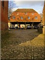SU9344 : Old granary at Home Farm, Peper Harow by Stefan Czapski