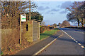 NY4659 : Bus stop alongside the A689 by Richard Dorrell