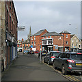 SK8608 : Oakham: crossroads and High Street by John Sutton