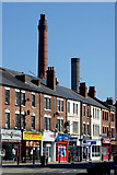 SO9098 : Shops and chimneys in Chapel Ash, Wolverhampton by Roger  Kidd