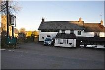 SS9531 : Brompton Regis : The George Inn by Lewis Clarke
