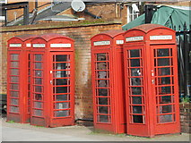 TQ3296 : Four red telephone boxes, Chapel Street Gardens / Church Street, EN2 by Mike Quinn
