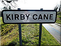 TM3793 : Kirby Cane Village Name sign by Adrian Cable