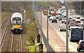 J3775 : Train and road traffic, Sydenham, Belfast by Albert Bridge