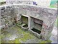 SK2956 : Feeding troughs in a disused pigsty by Humphrey Bolton
