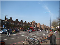 TQ3287 : View along Seven Sisters Road from outside Manor House tube station by Robert Lamb