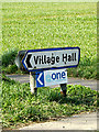 TM0959 : Village Hall sign on the A1120 by Adrian Cable
