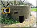 TG2931 : WW1 pillbox beside the road by Adrian S Pye