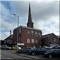 SN7204 : Car sales, telephone exchange and spire, Pontardawe by Jaggery