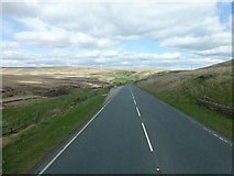 SE0210 : A straight stretch of the A62 near Pule Hill by Raymond Knapman