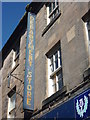 NT9952 : Berwick-Upon-Tweed Townscape : Old Department Store Sign In West Street by Richard West