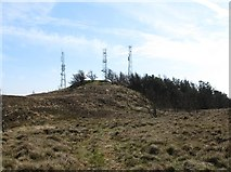 J0524 : The waymarked path from the summit approaching the masts by Eric Jones