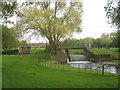 SK8844 : Weir, footbridge and gauging station by Jonathan Thacker