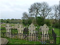 TF6510 : Family graves at The Church of St Botolph, West Briggs, Norfolk by Richard Humphrey