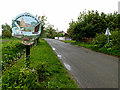 TM4693 : Wheatacre Village sign & Beccles Road by Adrian Cable