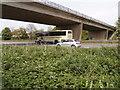 TL1395 : Coach, north bound, Alwalton by Michael Trolove