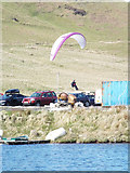 NS2472 : Paraglider landing at Ardgowan Fishery by Thomas Nugent