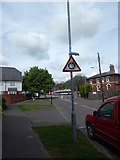 TM0321 : Roundabout sign on West Street, Wivenhoe by Hamish Griffin