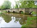 SP8982 : Geddington, roadbridge by Mike Faherty