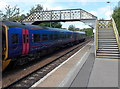 ST8745 : Train under footbridge at Warminster railway station by Jaggery