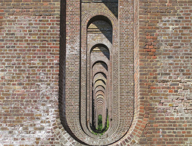 TL8928 : Under the arches, Chappel Viaduct by Roger Jones