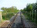 TQ9926 : View down the line to Dungeness by Marathon