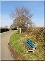 SX6856 : Bench Seat by the Roadside by Tony Atkin