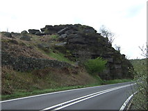 SK2773 : Rocky outcrop beside the A621 by JThomas