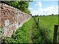 SU0255 : 'Path runs along the rear wall of Easterton Manor Farm' by Christine Johnstone