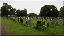 NT2875 : Graves in Seafield Cemetery by Graham Robson