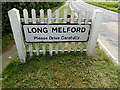 TL8544 : Long Melford Village Name sign by Adrian Cable
