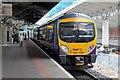 SJ8285 : First TransPennine Class 185, 185135, Manchester Airport railway station by El Pollock