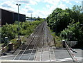 ST0381 : Distant train speeds towards Coedcae Lane level crossing, Pontyclun by Jaggery