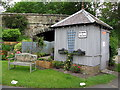 NZ0386 : Road bridge and wooden building at former Scots' Gap Railway Station by Andrew Curtis