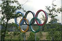 TQ3785 : View of the Olympic Rings from the top of the hill near the Velodrome by Robert Lamb