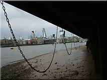 TQ3180 : View of the chains hanging from the side of the South Bank from the Thames Beach #2 by Robert Lamb